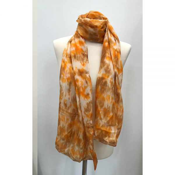 Hand painted long silk scarf in shades of orange and sandy brown.